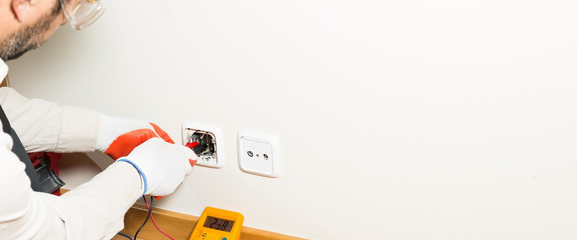 Zephyr Electrical technician repairing an electrical socket